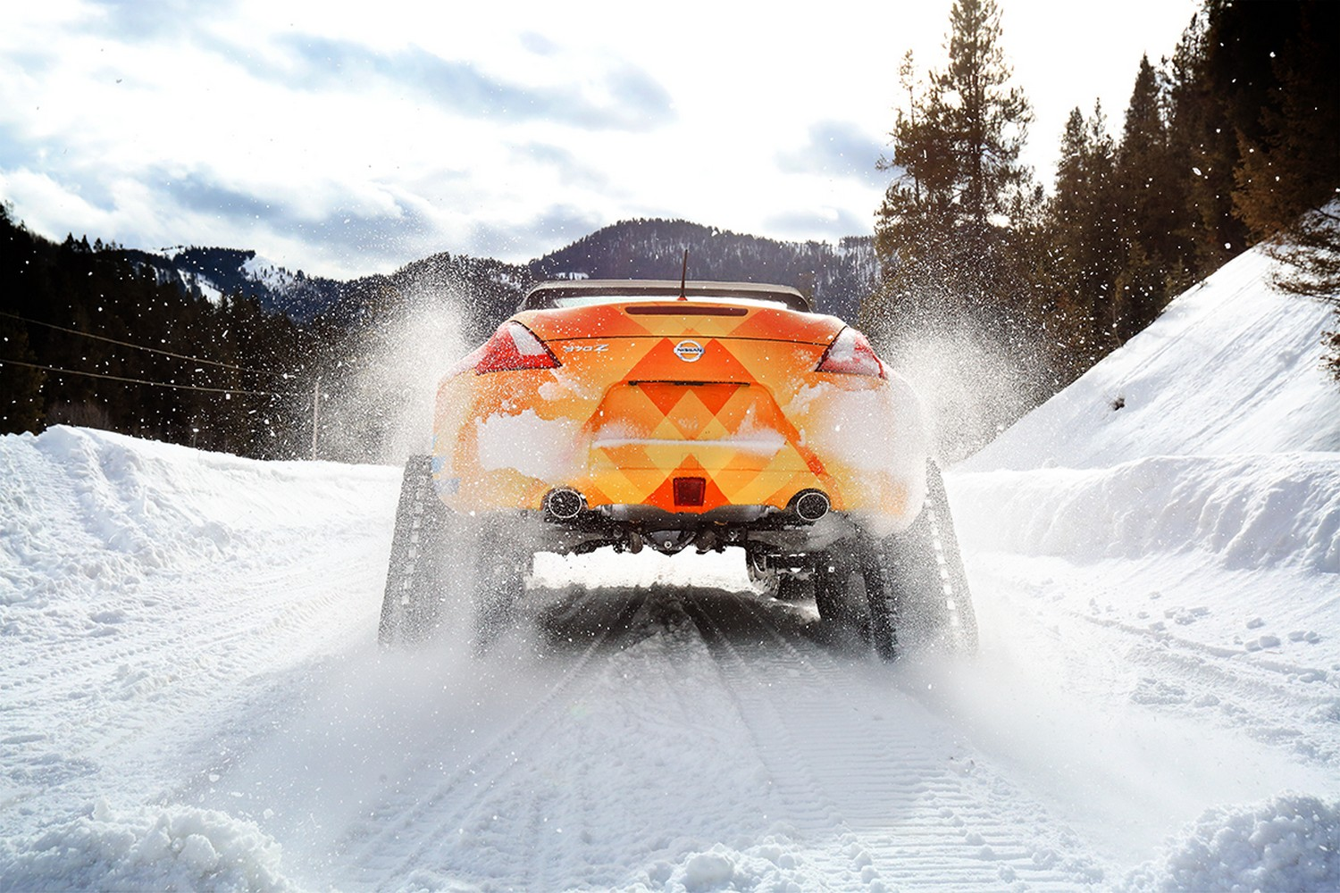 "Nissan is getting into the winter sports spirit with a specially constructed, one-off 370Z Roadster ""snowmobile."" Dubbed the ""370Zki"" – pronounced ""370-Ski"" – the 332-horsepower 370Z Roadster is ready to tackle ski slopes and backwoods trails alike with its front skis and rear snow tracks replacing the iconic sports car's usual high performance tires."