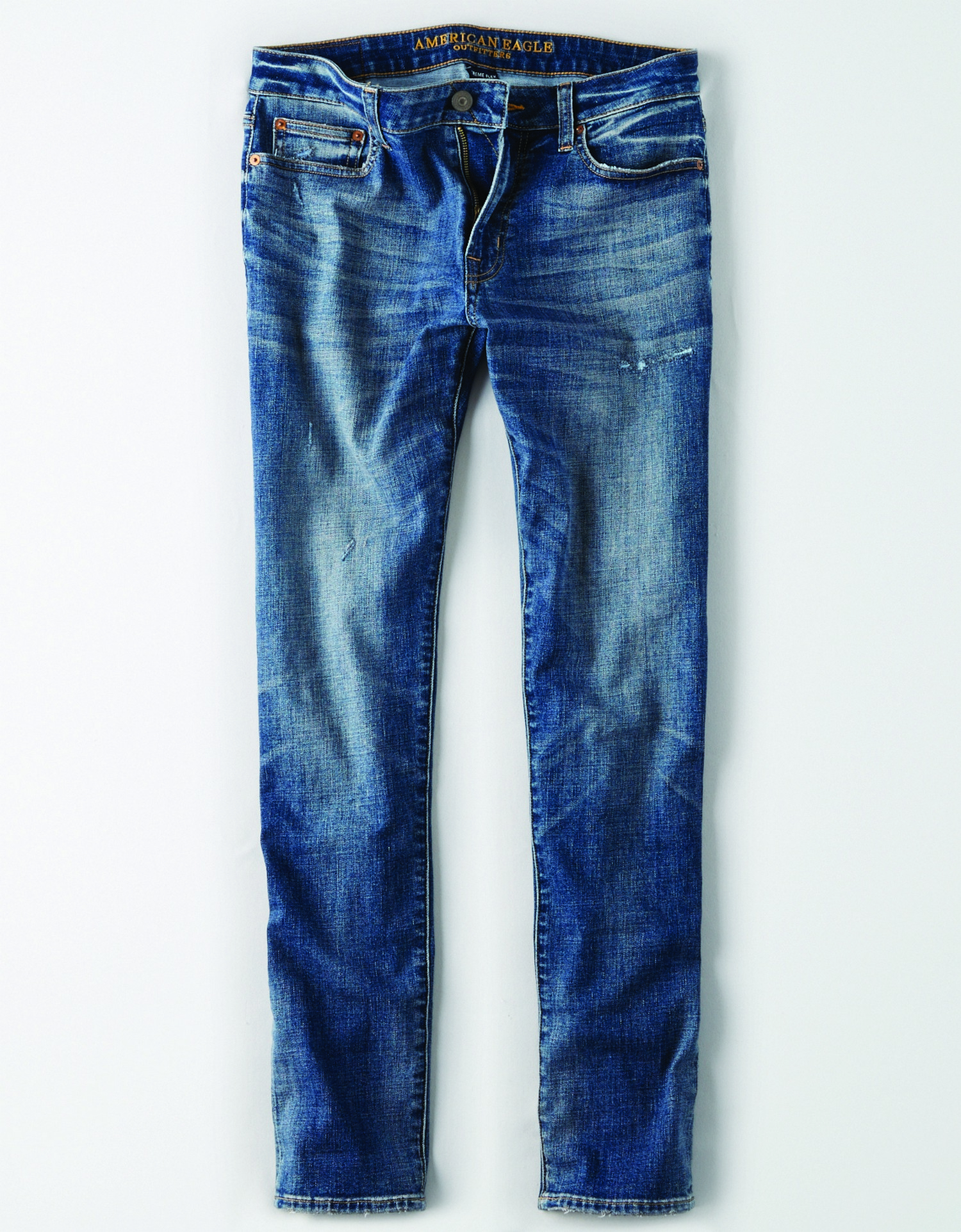 AE - INTL - Apparel - M - SLIM Denim Pant  - Medium Blue Wash - Shiny copper rivets - dull silver button - no destroy - light brush destroyy around edge of front pockets KS