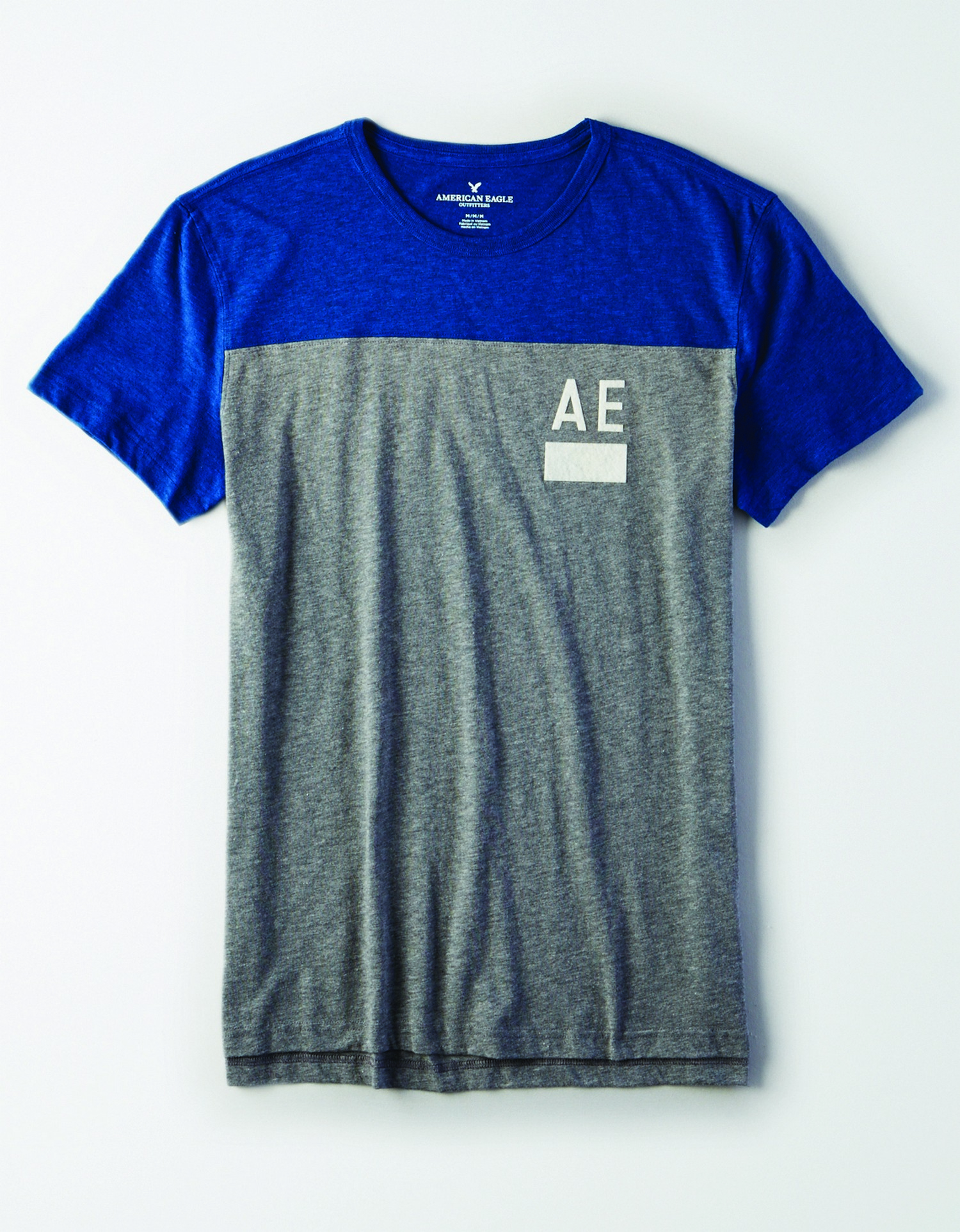 Ae INTL- M- Apparel-Graphic Tee- blue top and grey body s/s tee with white felt AE and block graphic on the left chest BG