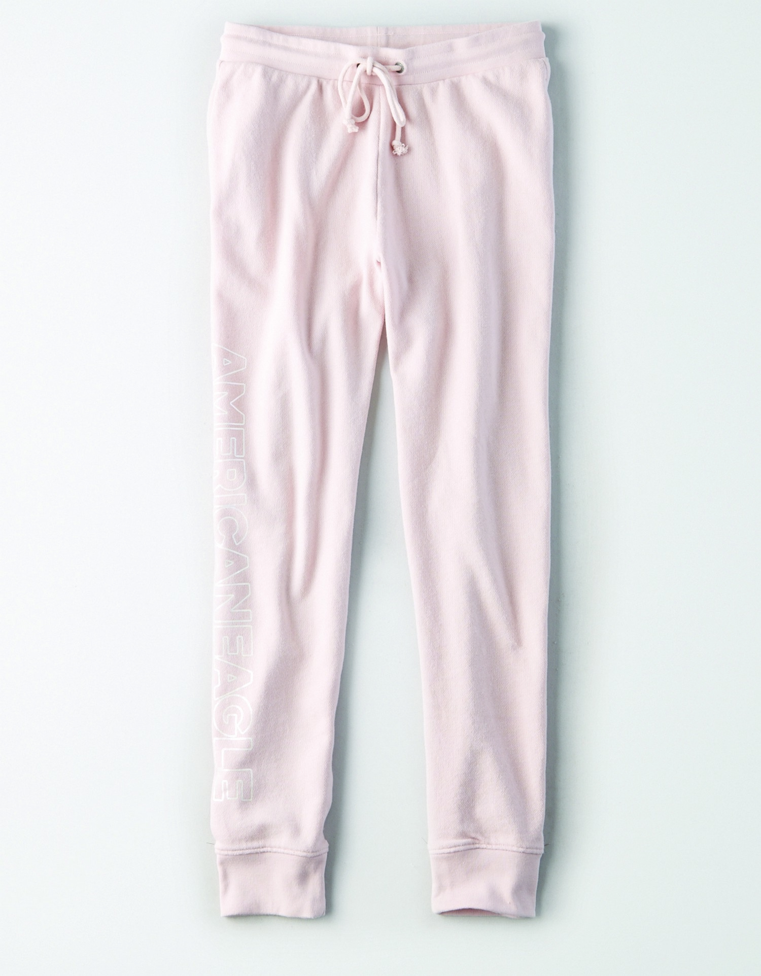 "AE - INTL - Apparel - W - Active Fleece pants  - Light Pink - white block letter graphic right leg - ""American Eagle"" AL"