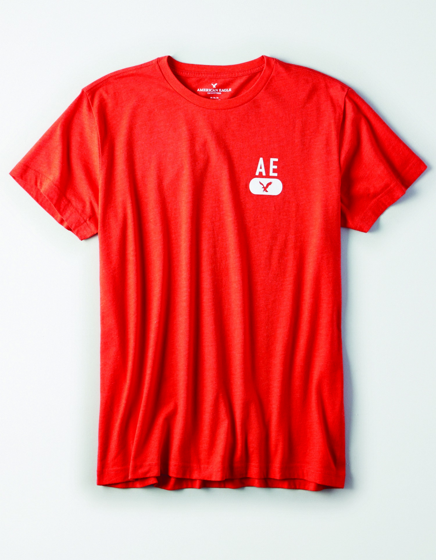 "AE - M - Apparel - SS VALUE TEE - Orange - smalle white graphic left chest ""AE"" w/Eagle JP *Tracked"