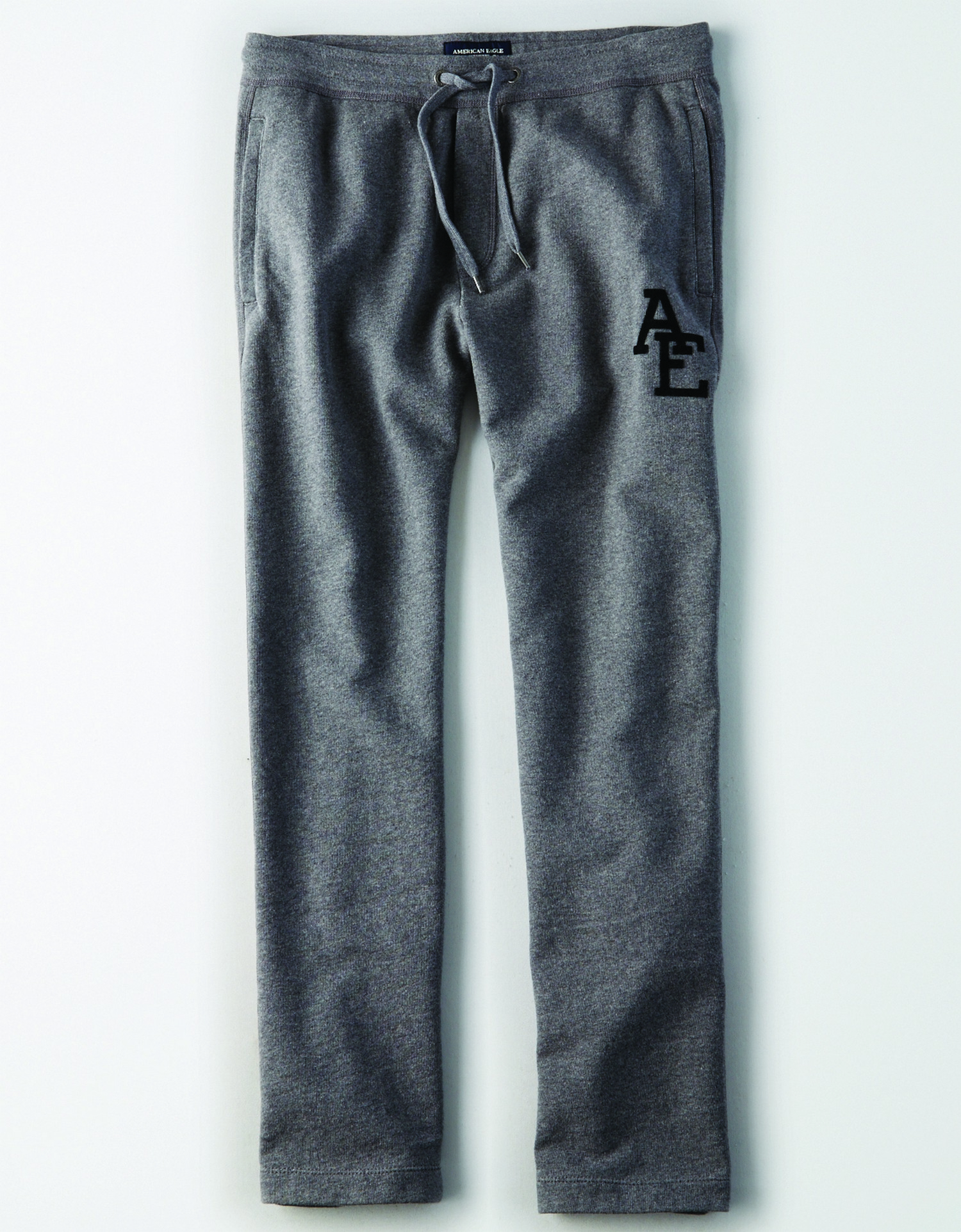 "AE - INTL - Apparel - M - Relaxed Jogger - Heatehr Grey - Solid Color - Grey drawstrings - Black ""AE"" on left leg KS *Tracked"